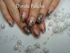 Silver glitter and black and white swirl design nail art