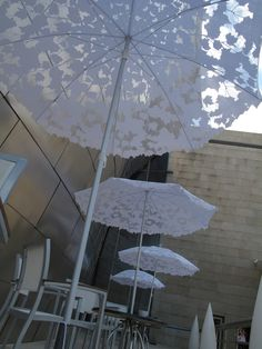 Shadylace parasol by Chris Kabel. This parasol allows just a little sun to shine through, creating a dappled shade. It comes complete with a small bird perched on top. www.sywawa.eu