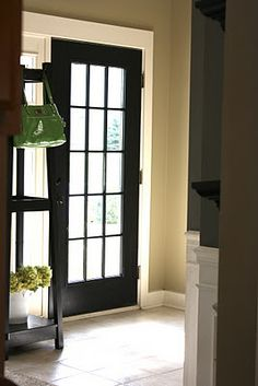 Foyer color : Martha Stewart Coir.  Love with black door & white trim!