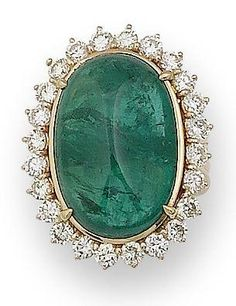Emeralderald and diamond cluster ring The oval cabochon emerald, within a brilliant-cut diamond surround, to a reeded hoop with tapered shoulders
