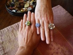 rings made with a shank button, 1mm elastic, seed beads, and crimps