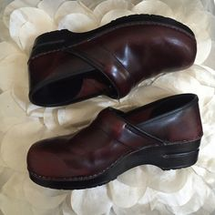 Burgundy Leather Dansko Clogs Comfy Burgundy Leather Dansko Clogs. Worn quite a bit with scuffing as shown in picture. Still has some life in them. Size Euro 40, Fits Women's 9 with socks or 9.5 without socks. Dansko Shoes Mules & Clogs