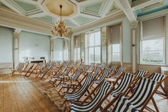 Several spaces still boast the building's original panelled walls and ornate cornicing. This includes the mint-green cinema room, where guests are invited to sit and watch the latest films or documentaries from striped deck chairs. Georgian Buildings, Mesa Exterior, Gun Rooms, Private Dining Room, Old Mansions, Cinema Room, Red Deer, Co Working, Hotel Interiors