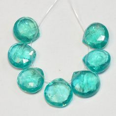 Neon Blue Apatite Faceted Heart Beads (7). $29.99, via Etsy.