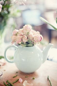 Pastel flowers in duck-egg blue teapot