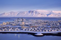 Snow covered Reykjavik with Mt. Esja in background, Iceland.