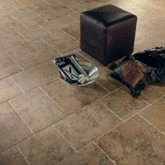 Ancient Fortress Carlisle Tiles -  Be the king and queen of your own castle with our Ancient Fortress Carlisle range. Inspired by the stonework of Carlisle Castle this collection of rich brown toned porcelain stone effect floor tiles will look perfect in your kitchen or living areas. So recreate authentic looking Roman stonework and start living like King and Queen!