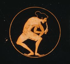 Red-figured kylix. Interior, within thin red circle: A nude woman (hair looped up with purple band, earrings), body to front, head to right, holds in either hand a phallos.  Attributed to The Nikosthenes Painter'; made by Pamphaios (potter). Athens,520-500 BCE.
