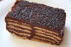 1- A receita de bolo mais fácil do mundo Ingredientes:  1 pacote de biscoitos doces 1 xícara de leite 1 barra de chocolate meio-amargo picada Chocolate granulado