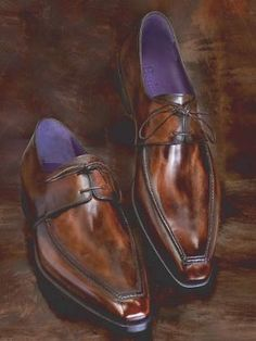 Belgian Dandy: Berluti: Bottier depuis 1895... Berluti is a company that manufactures and retails a very exclusive luxury brand of shoes and boots solely for men. It is known for its unique leather finishing. It also makes and sells a line of leather goods such as belts, bags, and wallets with similar finish.