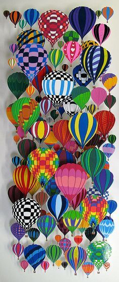 David Kravoc -  poster board balloons - intersperse these with light bulbs painted to look like balloons, fun foam sheets painted and cut to look like balloons ... ect  to add to the textural interest ... love the colors of this one - great idea for a travel agency or an airport shop