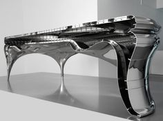Cool futuristic desk with silver finish you see below is designed by Jeroen Verhoeven.