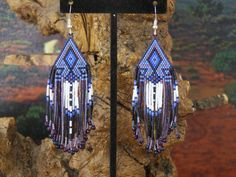 Cherokee Beaded Arrowhead Earrings In The Colors of Purples and Lavenders With A Eagle Feather Fridge by LJ Greywolf These Native American Beaded Earrings with my new arrowhead design are beaded with