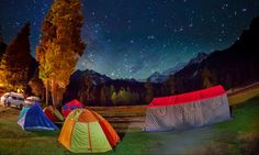 """Campsite in Rama Meadows. — """" One evening while sitting in the lawn of the Forest department's rest house, a group of female students of a Peshawar university decide to come and set camp.The group of about 200 girls set their camps site in no time """"- Syed Mehdi Bukhari"""