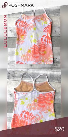 Power Y tank floral w/ citron & salmon on white Power Y tank has built in shelf bra.  Floral with leaf print done in warm pinks and citron.  Mesh accent at bust.  Has been in use, but no rips, tears or stains. Cute! lululemon athletica Tops Tank Tops