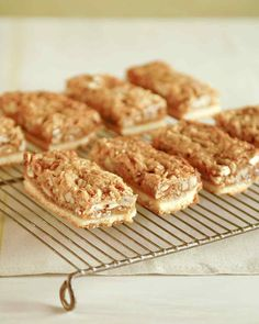 Pecan Bars. These sweet bars are like a hand-held version of pecan pie. Flaked coconut enriches the filling. When you're baking for a party, making these pecan bars that guests can hold in their hands is a great idea.