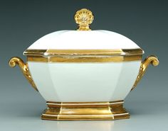 Old Paris porcelain tureen, canted corners with gilt borders and highlights, scrolled handles and shell finial, probably French, 19th century
