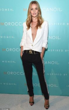 Rosie Huntington-Whiteley captures the light in plunging blouse - Celebrity Fashion Trends