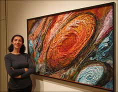 "Artist Yulia Hanansen with her ""Jupiter: Great Red Spot"" mosaic. The work won the Best of Show Prize at Mosaic Arts International 2011,an exhibition of contemporary mosaic artwork."