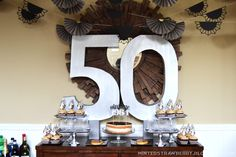 Stylish 50th birthday decorating idea with the big 5-0 front and center.  See more 50th birthday party decorations and party ideas at www.one-stop-party-ideas.com
