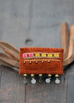 Rustic orange textile brooch with embroidery and by EnelinPedak, €16.00