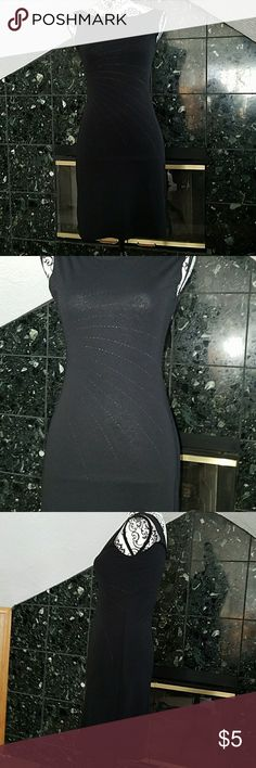 Black dress Form flattering black dress with sparkles on front.  Decent used condition. The glitter on front is fadded a bit. No tags.  Seems like a polyester spandex blend. Definitely a size small. Dresses