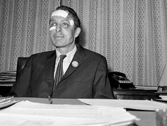 """James Peck of the Congress of Racial Equality (CORE) shows the effects of a beating he received in Anniston, Alabama as he answers questions at a press conference in New York City. As noted in """"Eyes on the Prize,"""" Peck spoke to a reporter in Birmingham on May 15, a day after the Anniston bus firebombing. """"I was beaten twice yesterday by hoodlums,"""" said Peck. """"Once aboard the bus and once in the terminal in Birmingham,"""" May 17, 1961.  Photo credit: AP / Jacob Harris — in New York, NY"""
