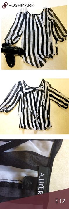 A Byer sz M striped dress top with bow back Super cute A Byer black and white striped dress top with bow on the back. Size Medium. Loose and flowy. Very cute for work with slacks. (Shirt only) a. byer Tops Blouses