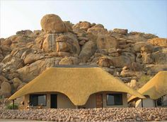 In the heart of Namibia lies a special wilderness area, encircled by the Erongo Mountains, where the desert, mountain, and bushveld ecosystems combine Hut House, Dome House, House Roof, South African Homes, African House, Thatched House, Thatched Roof, Round House Plans, House Plans South Africa