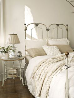 This is such a pretty look!!! Love it!  Antique French Bedroom  This antique cast-iron bed sports a cable-knit throw from the Martha Stewart Collection and a duvet cover by French Laundry Home. An Anthropologie teacup lamp sits atop the turned-leg nightstand for a graceful, elegant touch.    Read more: Bedroom Design Ideas - Guide to Bedroom Design - Country Living