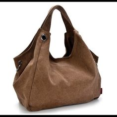 Spacious Canvas Hobo Bag Brand New with Tag.. Color: Brown.. Material: Canvas and Lining: Polyester   Dimension: 13.7 (L)*6.3 (W)*14.5 (H) Inches.                    Spacious inner space can accomodate iPad or note book,umbrella,cosmetics,wallets. Great for travel,school,outdoor activities,sports,daily use. Style: Use as a shoulder bag or crossbody messenger bag. Come with detachable adjustable shoulder strap.      If you want more pictures let me know. Bags Hobos