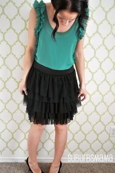 Cute dress refashion.  I love the colors and the ruffled sleeve.