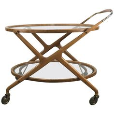 For Sale on - Classic Mid-Century Modern bar cart. Tea trolley designed by Cesare Lacca, glass shelves and brass details, original warm pearwood. Wine Glass Shelf, Glass Shelves In Bathroom, Floating Glass Shelves, Living Room Cabinets, Living Room Shelves, Dining Furniture, Cool Furniture, Bar Carts For Sale, Shelves Under Tv