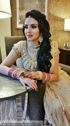 Indian bride wearing bridal lehenga and jewelry. #IndianBridalHairstyle #IndianBridalMakeup #IndianBridalFashion . Bride by Contoured Studios