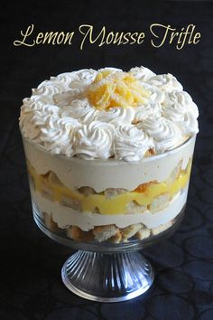 Lemon Mousse Trifle - a lemon lovers dream! It's a simple but delicious combination of sponge cake, lemon mousse, limoncello liqueur and whipped cream.