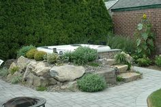 images above ground jacuzzi with rockscape   Above-ground Bullfrog Spas portable hot tub.