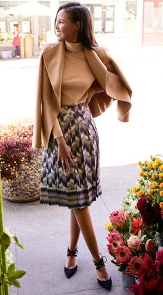 The perfect fall outfit - a camel colored jacket and turtleneck with a pleated chevron skirt and lace-up heels.