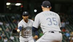 Roenis Elias Photos Photos - Roenis Elias #29 of the Seattle Mariners tosses the baseball to Mark Trumbo #35 to end the third inning of their game against the Houston Astros at Minute Maid Park on September 1, 2015 in Houston, Texas. - Seattle Mariners v Houston Astros