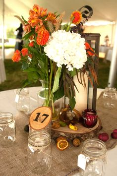 Combining a spectrum of earthy and fall colors, the late-afternoon wedding had an autumn rainbow of sage, burgundy, harvest gold, champagne and all the colors in between.