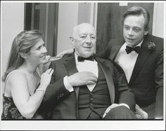 Actors Sir Alec Guinness with Carrie Fisher and Mark Hamill at a party to celebrate the 10th anniversary of their film 'Star Wars'