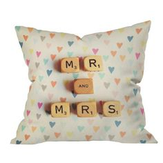DENY Designs pillow with brightly colored hearts and a board game tile-inspired inscription.     Product: PillowConstructi...
