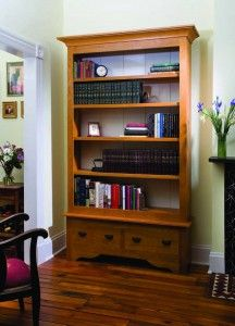 "Bibliophile's Bookcase With simple lines and straightforward joinery, this project yields ample shelf space (and drawers to boot) by Megan Fitzpatrick. This large case-on-case shelving unit is adapted from similar pieces I've seen in private libraries and in stately homes. I also dug up a few pictures from the Sotheby's and Christie's auction sites, where the form is referred to as  a ""bibliotheque"" (also the French word for library). FREE plans to download."