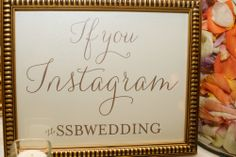 Hashtag wedding   Instagram wedding   gold frame   orange, purple and white rose petals in vase   candles   The Inviting Pear   Bouquets of Austin   Kristi Wright Photography   Pearl Events Austin
