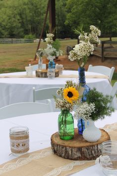 Southern Vintage antique vintage bottles for centerpieces at this beautiful rustic wedding at Morgan View Farm