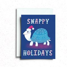 Snappy Holidays Turtle Greeting Card  - 4.25 x 5.5 (A2 size) card, printed on 12pt card stock. - Glossy coating on the front and back, uncoated inside for easy writing! - Blank inside.  Each card comes with a white envelope, safely packaged in a plastic sleeve.  ♥ This card is designed and printed in the USA, and packaged with care. ♥  Artwork © Katie Turner 2015  - - - - - - - - - - - - - - - - - - - - - - - - - - - - - - - - -  Lets be friends! ♥ Instagram: http://instagram.com&#x...