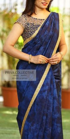 Best 12 PV 3554 : Navy blue satin silkPrice : Rs 4600 Get ready this wedding season in this cocktail sari in shades of navy blue. An out and out tie and dye patterned soft silk satin sari finished with golden kundan work borderUnstitched blouse piece – Na Golden Blouse Designs, Saree Blouse Neck Designs, Silk Saree Blouse Designs, Fancy Blouse Designs, Saree Blouse Patterns, Designer Blouse Patterns, Dress Neck Designs, Stylish Blouse Design, Fancy Sarees