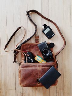 homeontherangefinder: What's in my bag? Ona Bowery Leica m4-2 w/ zeiss planar 50mm f2 Artisan obscura release Sekonic light meter Kodak tri-x 400 Leica m8 w/ summicron 40mm f2 Gordys strap Artisan obscura release Field notes book