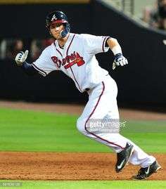Dansby Swanson of the Atlanta Braves takes second base unopposed...