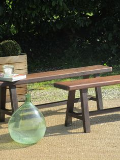 """A charming 19thcentury oak bench from Provence. Traditionally used as a dining table bench in a country kitchen this bench is solid and would be suitable to use at the end of a bed, in a hallway, at the kitchen table or outdoors. Sourced in L'enclave des papes.  Benches are sold individually. 10"""" wide x 59"""" long x 18"""" ¾ high 25cm wide x 150cm long x 47.5cm high"""