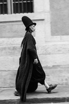 Lily Gatins wearing SKELETON cardigan by Knitted Lullaby. Hat - Henrik Vibskov .Dress - Cunning Ton & Sanderson. Shoes and socks - Comme des garçons. Photos by Yana Mironova
